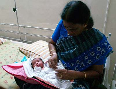 Amma with just born Aadhi.. his first day in earth